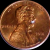 Bed bug egg on a penny to show size